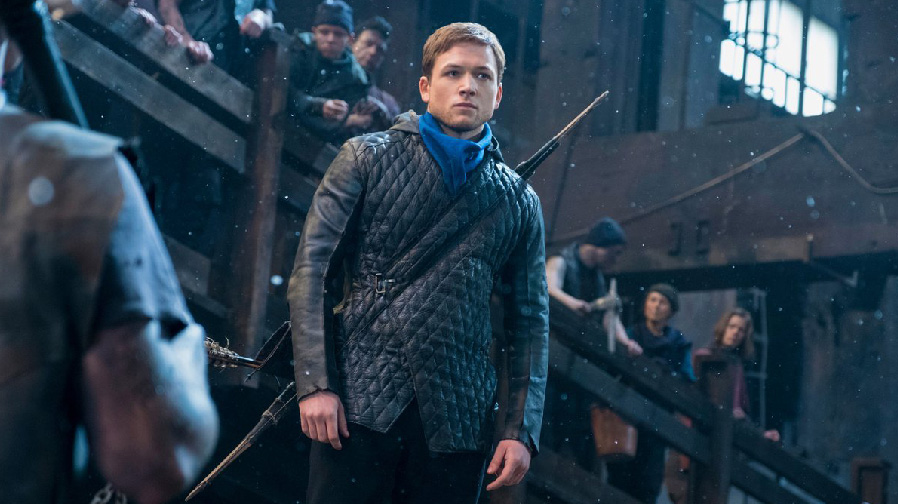 Taron Egerton notches his bow for new images from 'Robin Hood'